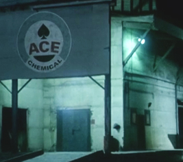 "Logo of ""Ace Chemical"" with purple lettering, bordered in gray, with a black spade, all on a white background."
